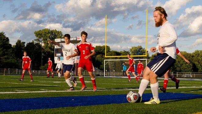 Vikings' Bryan Dinardo makes a pass Monday, Sept. 26, during boys soccer action against Port Huron at Marysville.