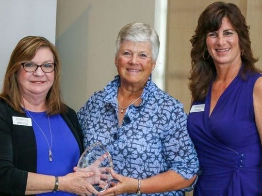 SafeSpace CEO Jill Borowicz, left, Sharon Beauchamp, and Tracy Levy. Beauchamp was the representative from Harbour Ridge Community in Palm City, which received the Chrysalis Award.