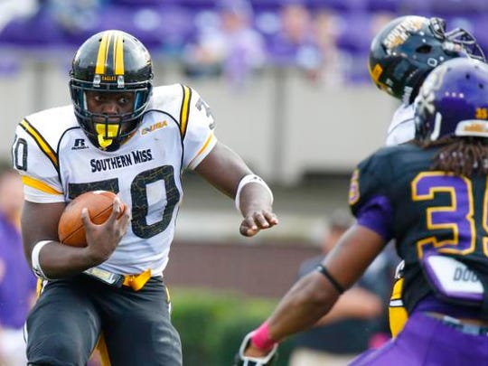 Southern Mississippi Golden Eagles running back Jalen Richard (30) carries the ball against the East Carolina Pirates during a 2013 game. Richard was signed by the Oakland Raiders as an undrafted free agent in May.