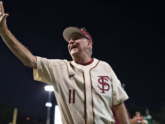 FSU Head Coach Mike Martin waves to the crowd while