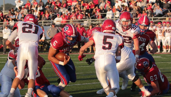 Licking Valley quarterback Jake Lewis charges through Johnstown's defense, but was stopped just yards away from the end zone. Valley scored on the next play and won 42-26.