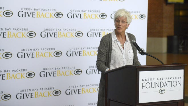 Tracy Arndt of Encompass Early Education and Care Inc. talks on Wednesday, June 20, 2018 about $250,000 impact grant her organization received from the Green Bay Packers Foundation.