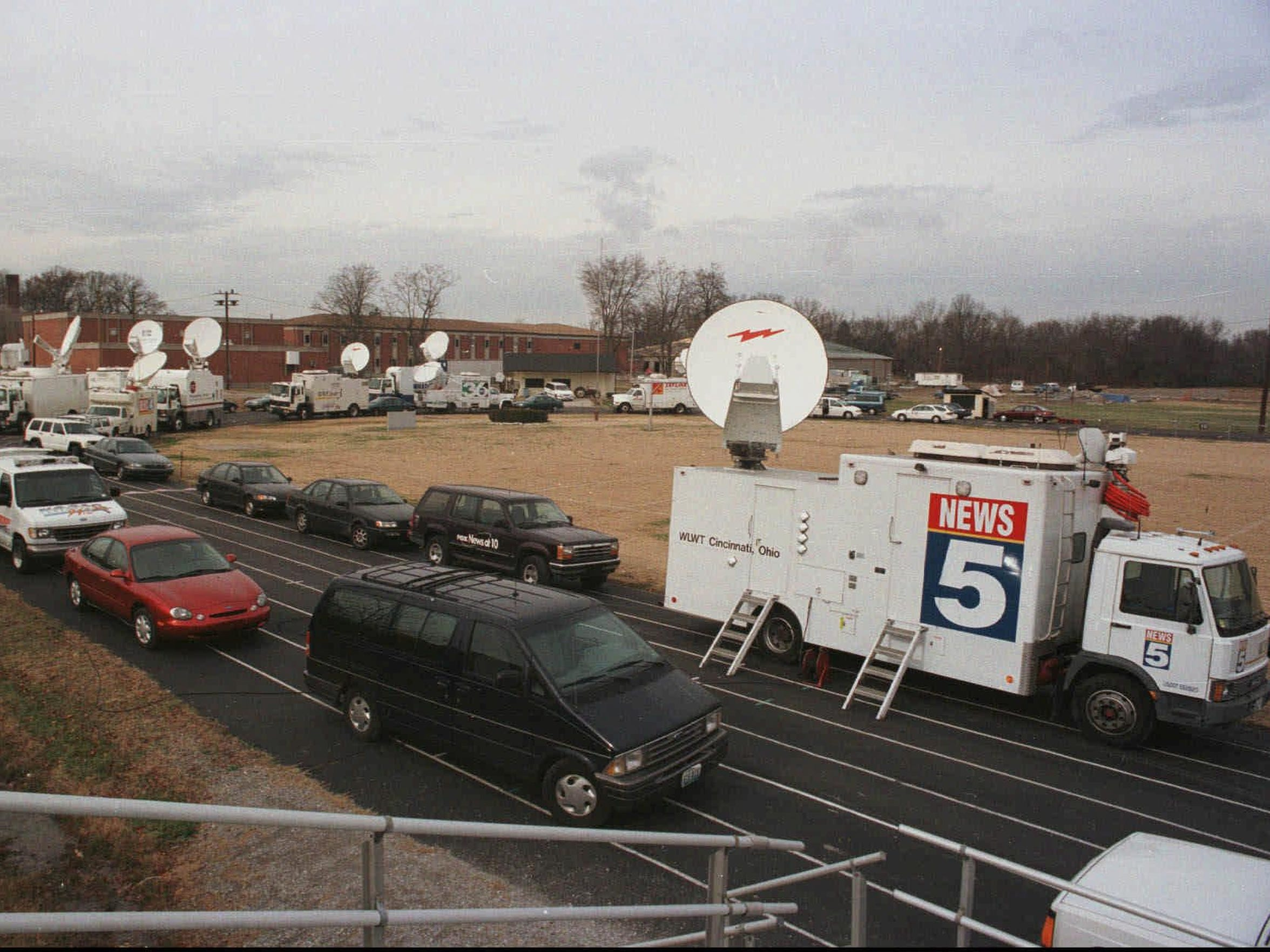 Media cars and trucks were parked almost bumper-to-bumper on the running track behind Heath High School on Dec. 1, 1997, the day a student opened fire, killing three classmates and injuring five more. Victim Hollan Holm, now 35, tells his story in Aftermath, a podcast focusing on gunshot survivors. (File photo/Pat McDonogh)
