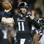 Bearcats quarterback Gunner Kiel throws a pass against Tulsa.
