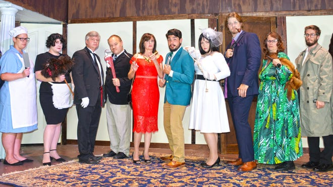 """The cast of Circle Theatre's production of """"Clue"""" includes (from left to right): James Raber (cop), Ashley Culp (cook), Jessy Recor (Yvette), Kell Anderson (Wadsworth), Dan Anderson (Col. Mustard), Donna Creech (Miss Scarlet), Joseph Sanders (Mr. Green), Meredith Raber (Mrs. White), Marion Young (Professor Plum), Renee Owens (Mrs. Peacock), Matthew Schulz (Chief of Police), and Melissa Eastering (motorist). Not pictured is John Buwalda (Mr. Boddy)."""