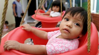 Children waiting for adoptions in Guatemala City, Guatemala, on June 12, 2006.