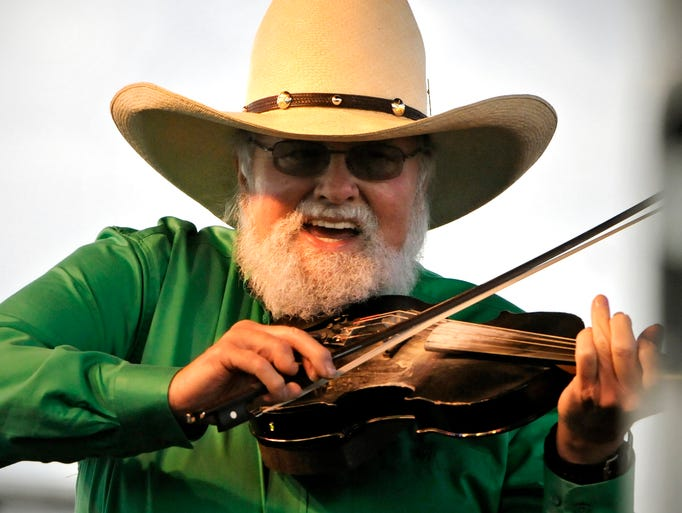 Charlie Daniels performs during Friday's Liberty Savings Block Party at Whitney Park in St. Cloud. Thousands were on hand for the free concert as part of Granite City Days.