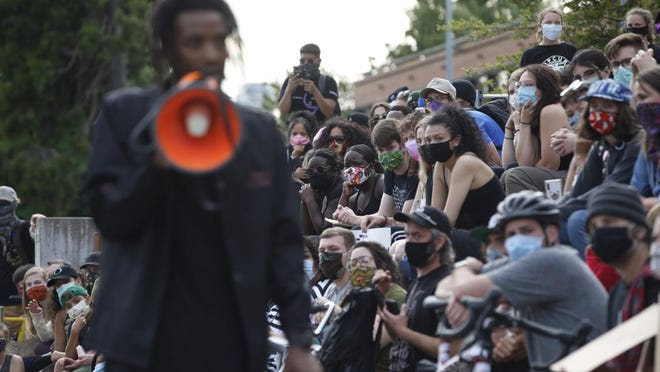 "Protesters listen as Moses Jackson reads from Aaron Dixon's ""My People are Rising"" on June 4 during the seventh night of protests for Black Lives Matter at the U.S. Courthouse in Eugene. [Andy Nelson/The Register-Guard file] - registerguard.com"