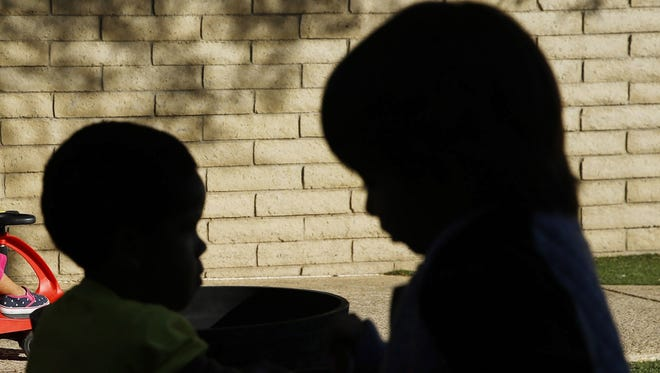 Children play outside in the child-development area on Nov. 22, 2016, at the Vista Colina Emergency Family Shelter in Phoenix. The shelter received a $30,000 Season for Sharing grant for the family shelter, and the support services offered there, such as child-development programs.