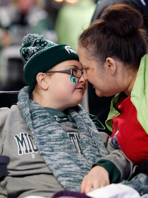 Brittany Van Hoogen gets a nuzzle and some words from her mother Candice, Saturday, Jan. 6, 2018, at Munn Arena for MSU's hockey game against Ohio State. She died nine days after the photo was taken.