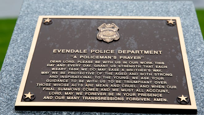 """""""A policeman's prayer"""" plaque at the Village of Evendale, Veterans, Fire and Police Tribute Tower. Photo shot Tuesday April 24, 2018."""