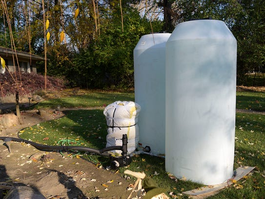 Two water tanks outside of resident Justin Droste's