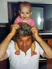Richard Koff holds granddaughter Caroline Scott in this submitted photo.