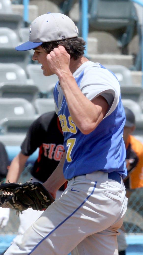 North Salem pitcher Rian Balbino pumps his fist after