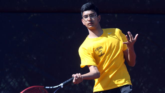 South Brunswick's Avi Rahadive returns a volley during his match against Edison on Wednesday.