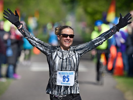 Amy Feit of Luvurne is the first woman to cross the finish line during Saturday's Lake Wobegon Trail Marathon in St. Joseph.