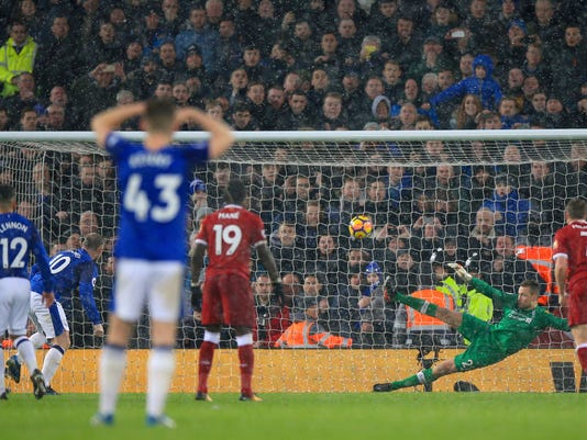 Everton's Wayne Rooney, second left, scores his side's first goal of the game from the penalty spot during their English Premier League soccer match against Liverpool at Anfield, Liverpool, England, Sunday, Dec. 10, 2017. (Peter Byrne/PA via AP)