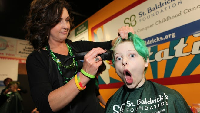 Many people in Murfreesboro had their heads shaved to raise money for cancer during the Bald in the Boro event on Friday March 13, 2015.