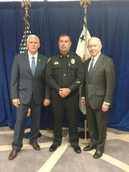 Jackson Police Department Capt. Phillip Kemper, center,
