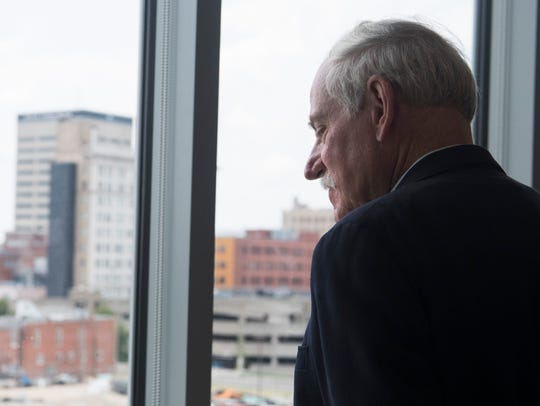 Jeff Marston looks out at the progress of downtown