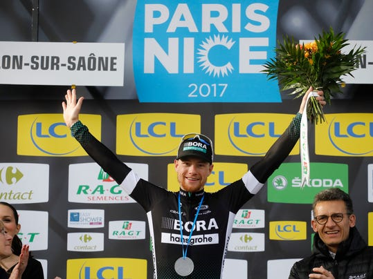 Sam Bennett, of Ireland, celebrates on the podium after winning the third stage of the Paris Nice cycling race between Chablis and Chalon-sur-Saone, France, Thursday, March 7, 2017. (AP Photo/Laurent Cipriani)