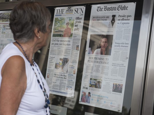 The front page of the Boston Globe on display outside the Newseum in Washington DC on August 16, 2018.