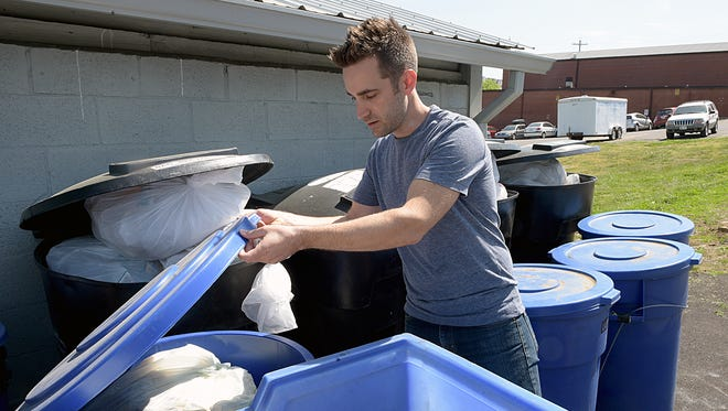 Ben Lehman, co-owner of Crema, shows the recycling containers full of waste from the Nashville coffeehouse.