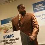 Mayor Kwame Kilpatrick makes remarks regarding the announcement of the first new DMC campus building in 30 years at Children's Hospital of Michigan Thursday, May 15, 2008. As he takes a question from the media he looks to  DMC Chief Executive Officer Mike Duggan.The new facility will be a 75,000 square foot outpatient pediatric center directly across from the main hospital located at 3900 Beaubien. Its cost is estimated at $34 million. REGINA H. BOONE/Detroit Free Press