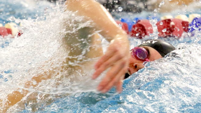 Kaelan Winkky of Horseheads competes in the 400-yard freestyle relay during Saturday's Section 4 championships at Owego Free Academy.