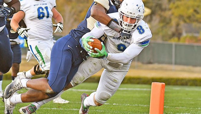 University of West Florida tight end Austin Blake-Smith stretches the ball out to score a touchdown against Wingate University in an NCAA Division II playoff game on Saturday in Wingate, North Carolina. UWF won, 31-0.