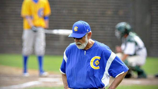 Cathedral coach Bob Karn coaches from the third base line during a game in this file photo.