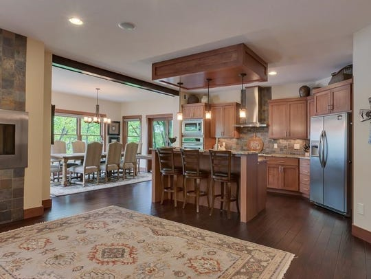 Tiger wood flooring leads the way into both the kitchen