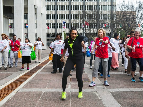 "April 5, 2017 - Yvonne Parron, wellness coordinator, City of Memphis, leads a group of people in the ""Cupid Shuffle"" during the local 2nd annual National Walking Day event at City Hall on Wednesday. The American Heart Association set a goal of 1 million steps walked across the Mid-South. Memphis and Shelby County leaders challenged city employees to donate their steps before they led a round-trip walk from City Hall to Memphis Light, Gas and Water in Downtown Memphis. National Walking Day was birthed in 2007 by AHA in its efforts to encourage healthy living. The event is observed every first Wednesday in April."
