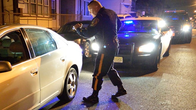 """Police departments throughout New Jersey will take park in the """"Drive Sober or Get Pulled Over"""" campaign running until Jan. 1, 2017. Pictured are Passaic County Sheriff's officers during last year's campaign."""