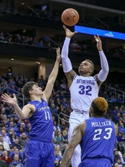 Seton Hall guard Derrick Gordon shoots as Creighton's Tyler Clement defends in a January game in Newark, New Jersey. Gordon was the first openly gay player in Division I men's basketball