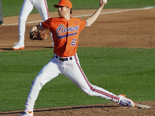 Clemson junior pitcher Charlie Barnes (23) pitches to Wright State during the top of the third inning at Doug Kingsmore Stadium in Clemson.