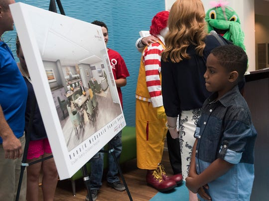 Jace Gatlin, 7, looks at the rendering of a new Ronald McDonald Family Room being planned for the new Studer Family Children's Hospital at Sacred Heart in Pensacola on Tuesday, June 6, 2017. The new facility is currently under construction.