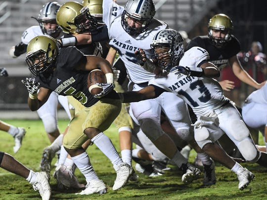 Pendleton's Jaylon Walker runs by Powdersville junior Tay Cureton (13) during the fourth quarter at Pendleton High School in Pendleton on Friday.