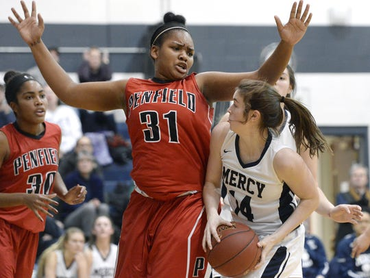 Penfield's Nyara Simmons, left, defends against Mercy's