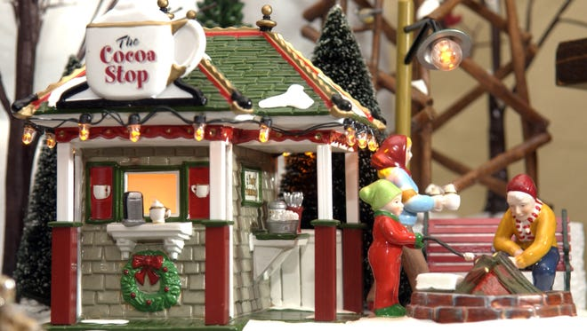 Department 56 makes miniature houses and villages prized by collectors.
