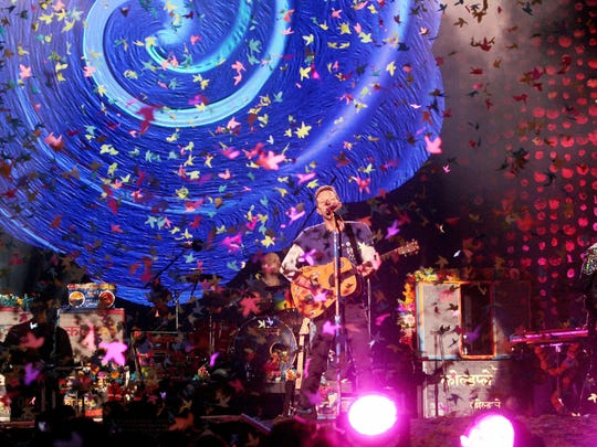 Singer Chris Martin (C, front) of the British rock band Coldplay perfoms on stage during their concert in Santiago de Chile, Chile, 03 April 2016. The performance is part of Coldplay's Latin American tour named 'A head full of dreams.'
