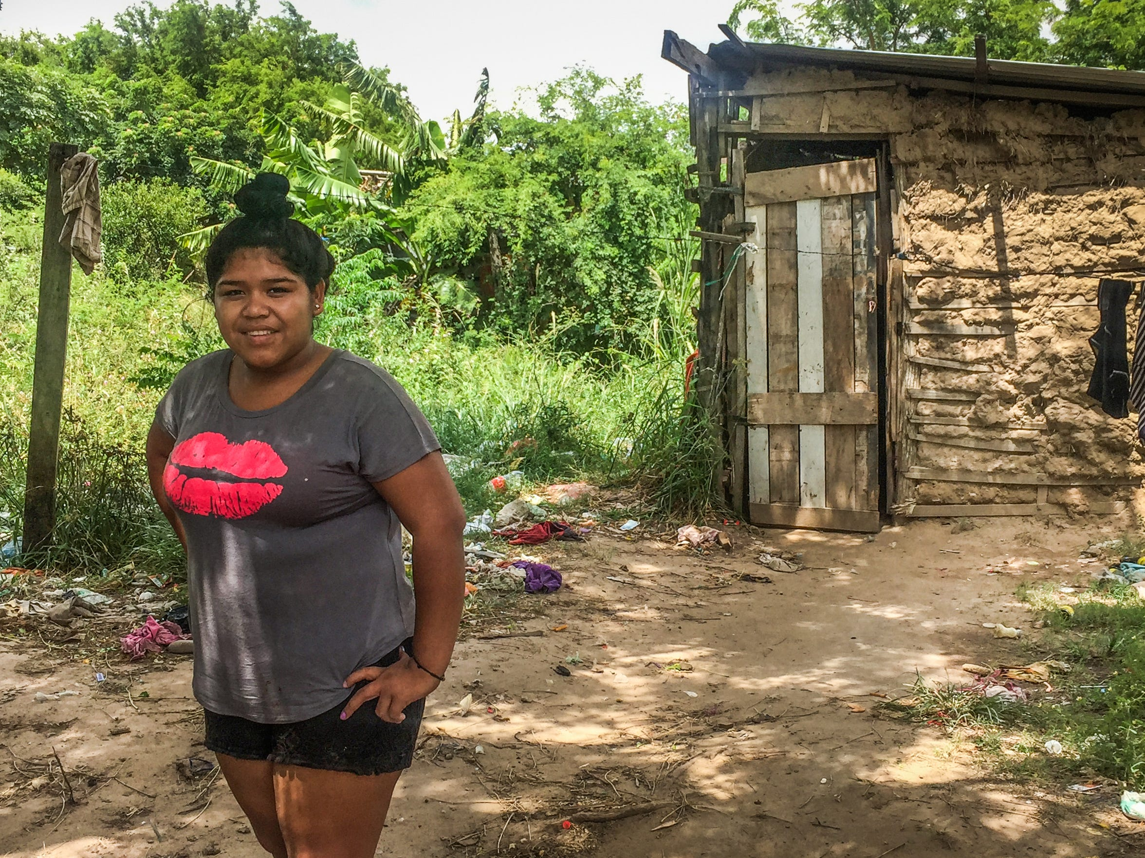 Api, at 17, has never attended school.  She lives in the shack behind her with as many as seven other abandoned and orphaned children in a village near Santa Cruz de la Sierra, Bolivia.