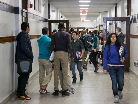 Students pour into the hallway during the change of