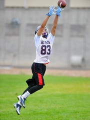 Great Falls High wide reciever Kody Torgerson makes a leaping catch during passing drills, Friday morning.