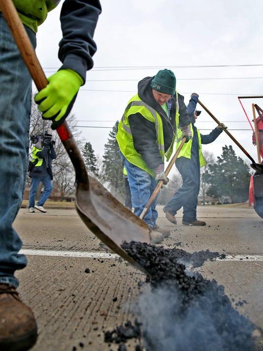 IndyStar stock pothole stock potholes stock patching potholes stock filling potholes stock road repairs stock roadwork