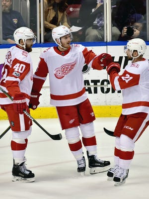 Gustav Nyquist (center) celebrates his goal with center Henrik Zetterberg (left) and left wing Tomas Tatar (right) during the second period of the Red Wings' 3-2 shoot-out win over the Panthers on Saturday, Oct. 28, 2017, in Sunrise, Fla.