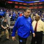 Kentucky's John Calipari arrives to the court for the start of practice at the Louisville Regional Wednesday afternoon. By Matt Stone, The Courier-Journal March 18, 2015