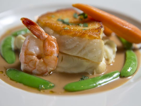 An entree of pan-seared Chilean sea bass and butter-braised