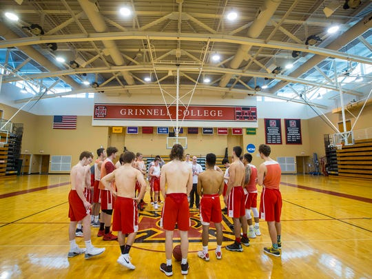 Grinnell menÕs basketball players listen to head coach Dave Arseneault, Jr. Tuesday, Jan. 9, 2018, in Grinnell, Iowa.