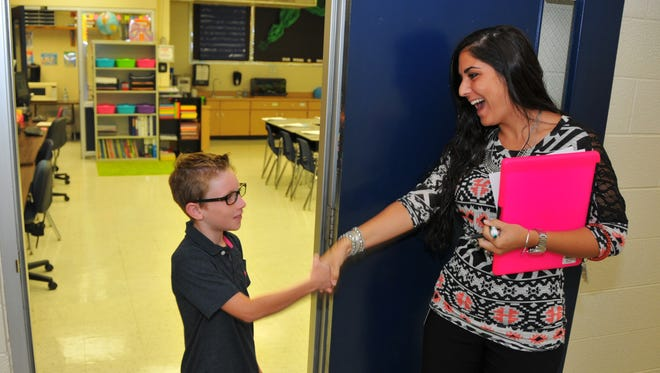 Garret Cox is greeted by his 3rd grade teacher Shannon Albright. Brevard County Schools plans to raise teacher pay and improve benefits.